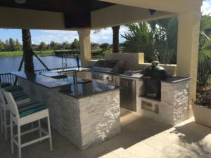 full_outdoor_kitchen_with_island_by_water